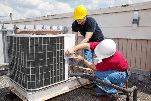 image of people checking heating and a/c
